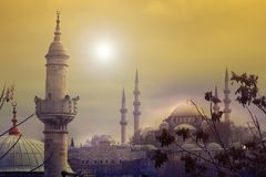 The sun sets behind the Suleymaniye Mosque in Istanbul. The sun sets next to the impressive Suleymaniye Mosque. one the most famous architectural achievements of royalty free stock photo