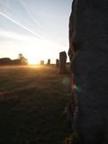 Sun sets over Avebury stone circle Stock Photos