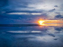 The sun sets over beach. With beautiful reflection Stock Photos