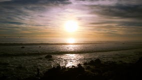 Sun sets over coast in California stock footage
