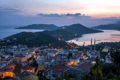The sun sets over the fishing village of Kas on the Mediterranean coast of Turkey. Stock Photography