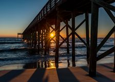 Sunset under a pier stock image