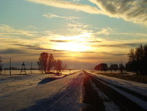 Sunset over the road. The sun sets over the horizon in red steppe Stock Images