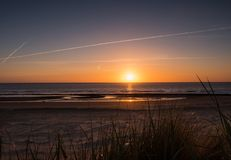 Sun sets over the island of Ameland, Holland Royalty Free Stock Photography