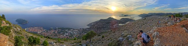 The sun sets over the islands of the Adriatic Sea. Croatia - Dubrovnik - Watching the sunset atop Mount Srd, with Dubrovnik and the Adriatic Sea far below royalty free stock image