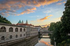 Sun sets over the still waters of the Ljubljanica River, Slovenia. stock photography
