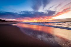Ocean reflections of a sunset over Monterey Bay stock photo
