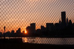 Sunset New York City Chainlink. Sun sets over New York City through a chainlink fence Stock Image