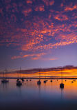The Sun sets over Poole Harbor in Dorset at Hamworthy pier jetty Royalty Free Stock Image