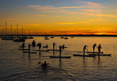 The Sun sets over Poole Harbor in Dorset at Hamworthy pier jetty Royalty Free Stock Photography