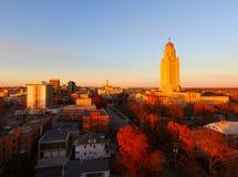 Fall Color Orange Tree Leaves Nebraska State Capital Lincoln. The sun sets over the State Capital Building in Lincoln Nebraska stock photos
