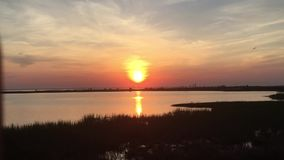 Sun sets over the water stock video footage