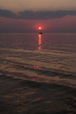 The sun sets in the sea on the background of yachts Royalty Free Stock Photos