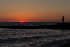 The sun sets. In the sea on a warm summer evening Royalty Free Stock Images