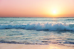 Sun sets on Seven Mile Beach. Sunset light catches the top of a wave on Grand Cayman's Seven Mile Beach Royalty Free Stock Photography