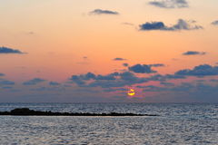 Sun setting above Laccadive Sea Royalty Free Stock Image