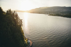 Sun Setting Above River and Mountain Royalty Free Stock Photography