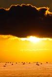 Sun setting across farmland Stock Photos