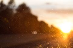 Road Glare through a Window on the Highway. The sun is setting along a stretch of highway. The glare is coming through the windshield and hitting specs of dirt Royalty Free Stock Photos