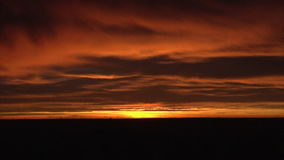 Sun setting amid clouds stock video footage