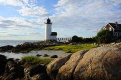 Sun setting by Annisquam lighthouse in Massachusetts Stock Photos