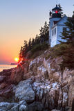 Sun Setting behind Bass Harbor Lighthouse Royalty Free Stock Images