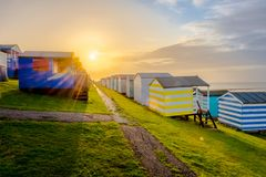 Beach huts. Sun setting behind beach huts on the south coast of england royalty free stock photography
