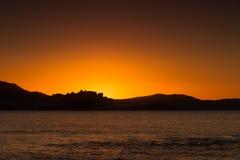 Sun setting behind Calvi citadel in Corsica Stock Photo