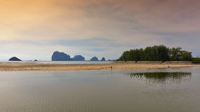 Sun setting behind the hilly islands of Andaman Sea Royalty Free Stock Photography
