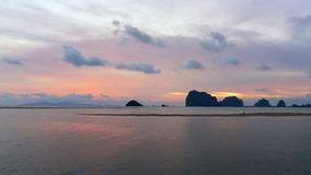 Sun setting behind the hilly islands and cliffs at Krabi, Thailand Stock Photo