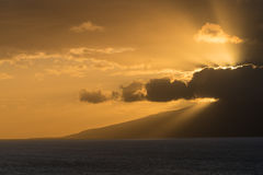 Sun setting behind the island of Molokai from Maui Stock Photography