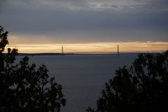 Mackinac Bridge III. Sun setting behind the Mighty Mackinac Bridge as seen from Mackinac Island in November 2017 stock photography