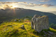 Sun setting behind the mountain Royalty Free Stock Photo