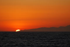 Sun setting behind pt dume Royalty Free Stock Image