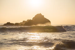 Sun setting behind rocks at Pfeiffer State Park, Big Sur, Califo Stock Image