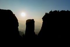 Sun setting behind sandstone rocks. Royalty Free Stock Image