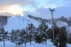 Sun Setting Behind the Slopes Stock Photography