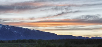 Sun setting behind the Tetons, Grand Teton National Park Stock Image