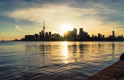 Sun setting behind Toronto`s downtown city skyline stock image
