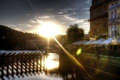 Sun setting on a blue sky over dark cityscape and a river Vltava in Prague, Czech republic Stock Photography