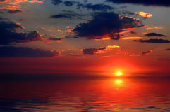 Sun Setting with Clouds Stock Image