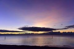 Sun setting, creating a beautiful purple sky Royalty Free Stock Images