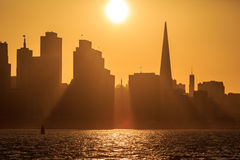 Sun setting directly in gap of skyline behind San Francisco Royalty Free Stock Photo