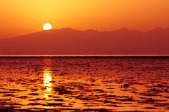 Sun is setting down above sea Stock Photography