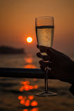Sun setting through a glass of champagne Stock Photography