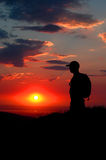 Sun Setting with Hiker. Sunset with silhouette of man hiking royalty free stock photos