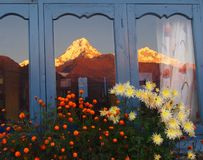 Himalayan mountains reflected in the window Stock Image
