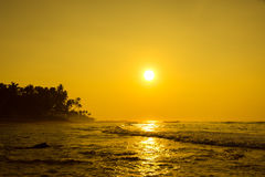 Sun Is Setting On Horizon At Sunset. Sunrise Over Sea Or Ocean. Royalty Free Stock Images