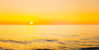 Sun Is Setting On Horizon At Sunset Sunrise Over Sea Or Ocean. Royalty Free Stock Image