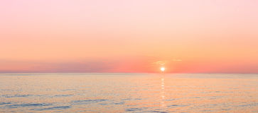Sun Is Setting On Horizon At Sunset Sunrise Over Sea Or Ocean. Royalty Free Stock Photography